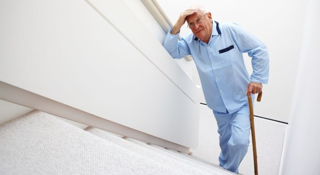 Elderly Man Walking Up a Set of Stairs
